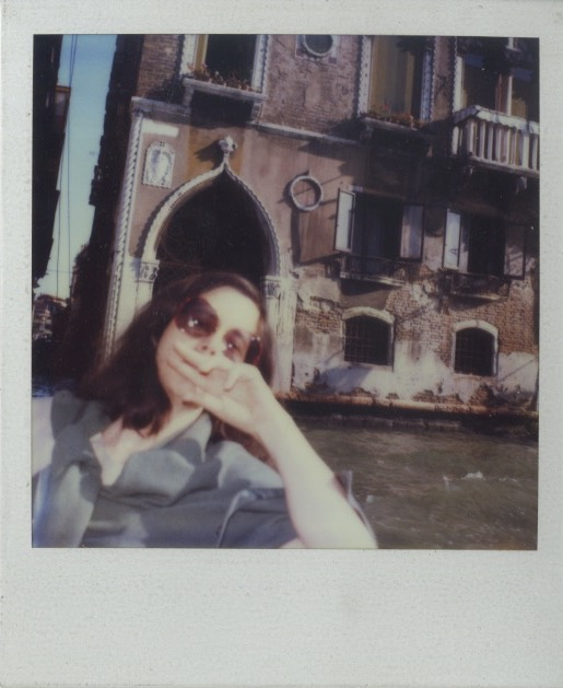 Polaroid of Madeline on a boat in Venice