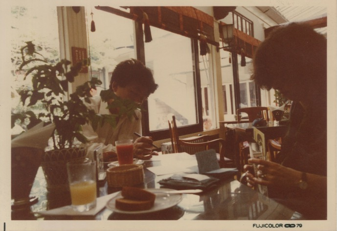 Arakawa and Madeline writing at a breakfast table in Japan (1979)